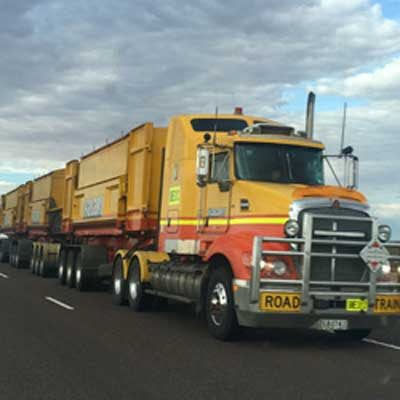 Yellow Semi Hauling Cargo